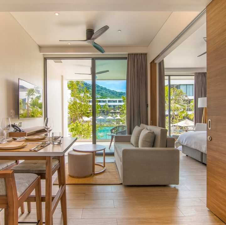 1 Bedroom Suite | STAY-WELLBEING-LIFESTYLE-RESORT_ONE-BEDROOM-SUITE-POOL-VIEW_DINING-AREA_COVER