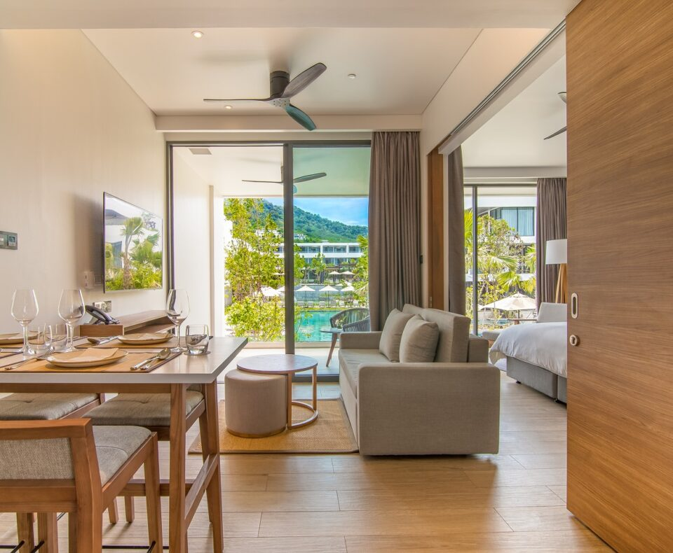 1 Bedroom Suite : STAY-WELLBEING-LIFESTYLE-RESORT_ONE-BEDROOM-SUITE-POOL-VIEW_DINING-AREA_COVER